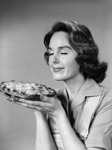 1950s-1960s-woman-smelling-aroma-of-freshly-baked-pie